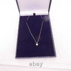 18ct gold 1/2ct diamond heart pendant on 9ct gold chain boxed
